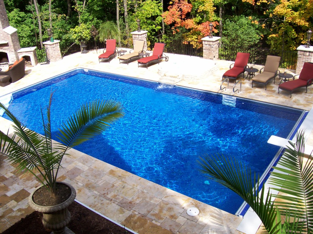 Pool liners patio pleasures for Decor around swimming pool